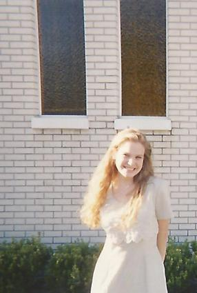 Me, age 15, posing outside of church